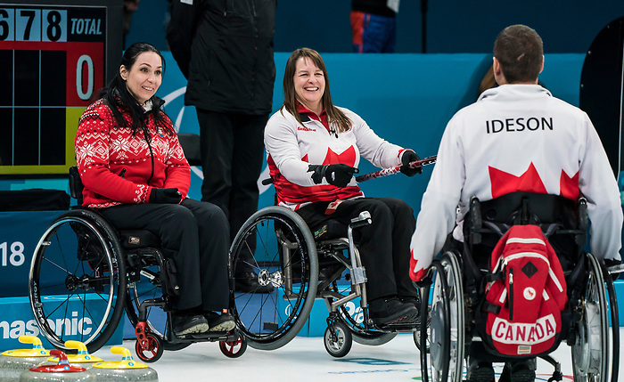 PyeongChang 14/3/2018 - Third Ina Forrest shows skip Mark Ideson how much he missed by as Canada takes on Slovakia in wheelchair curling at the Gangneung Curling Centre during the 2018 Winter Paralympic Games in Pyeongchang, Korea. Photo: Dave Holland/Canadian Paralympic Committee