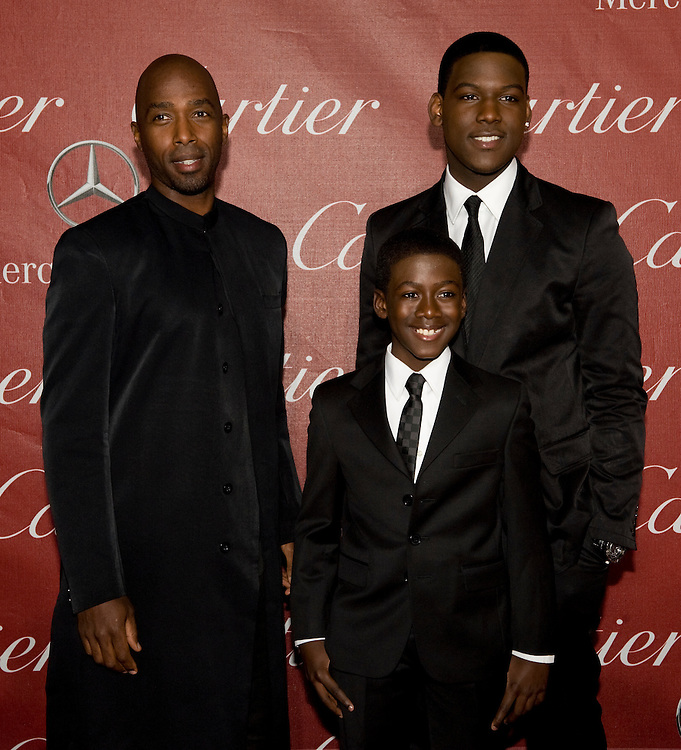 """From left: Ntare Guma Mbaho Mwine, Kwesi Boakye and Kofi Siriboe, cast members of the movie """"40"""" pose for the cameras during the Palm Springs International Film Festival red carpet event at the Palm Springs Convention Center on Saturday."""