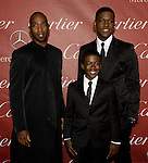 "From left: Ntare Guma Mbaho Mwine, Kwesi Boakye and Kofi Siriboe, cast members of the movie ""40"" pose for the cameras during the Palm Springs International Film Festival red carpet event at the Palm Springs Convention Center on Saturday."