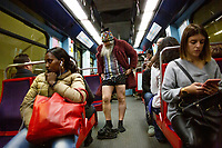 LISBON - PORTUGAL 12: Participants of the No Pants Subway Ride ride a train on January 12, 2020 in Lisbon, Portugal. The annual event, in which participants board a subway car in January while not wearing any pants while behaving as though they do not know each other, began as a joke by the public prank group Improv Everywhere in New York City and has since spread around the world, with enthusiasts in around 60 cities and 29 countries across the globe, according to the organization's site. <br />