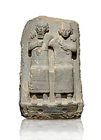Hittite monumental relief sculpture of of two seated figure, not a typical Hittite style with a lot of other influences. Late Hittite Period - 900-700 BC. Adana Archaeology Museum, Turkey. Against a white background