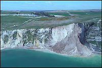 BNPS.co.uk (01202 558833).Pix: MCA/BNPS..***Please Use Full Byline***..A massive cliff has struck the Dorset Jurassic coast today near Durdle Door. Tens of thousands of tones of rock has come crashing down onto a remote beach in St Oswalds Bay. The MCA helicopter spotted the fall.