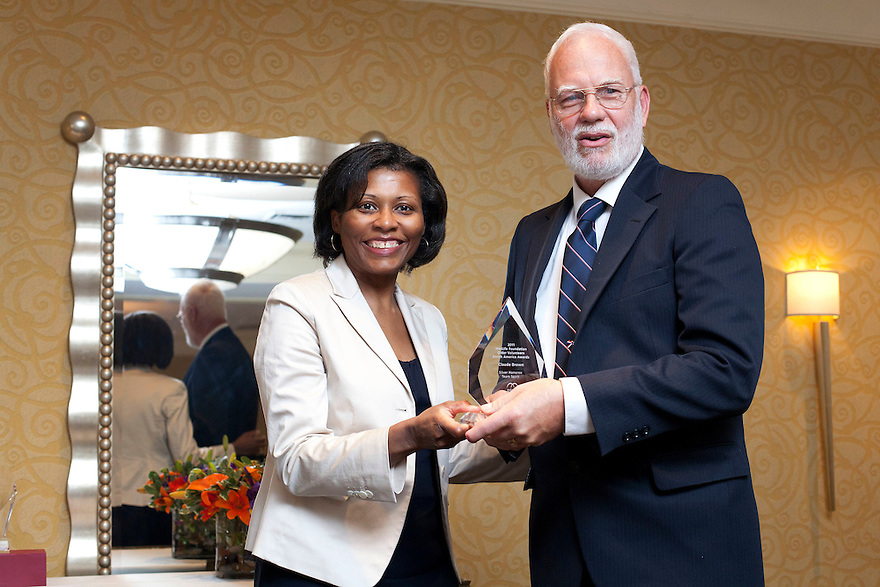 April Hawkins gives Claude Brown his award at the Older Volunteers Enrich America Awards at the Double Tree Hotel in Washington, DC on Friday, June 17, 2011.