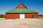 Red wooden barn with green roof in central Oklahoma