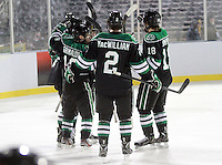 North Dakota celebrates Danny Kristo's goal during the third period. North Dakota beat Nebraska-Omaha 5-2 in the outdoor game at TD Ameritrade Park on Saturday, Feb. 9, 2013. (Photo by Michelle Bishop)