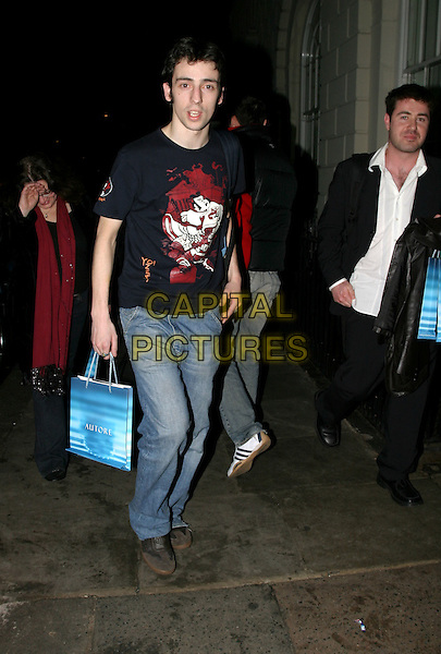 RALPH LITTLE.Pre-Bafta party at Sketch nightclub.11 February 2004.full length, full-length, denim jeans, t-shirt, goody bag, goodie bag, Ralf.www.capitalpictures.com.sales@capitalpictures.com.© Capital Pictures.