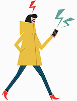 Woman walking and concentrating on smart phone