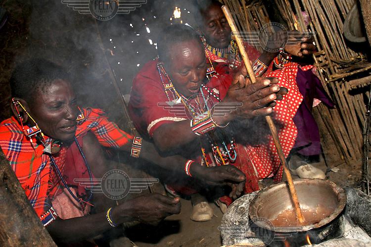 Masai women cooking.