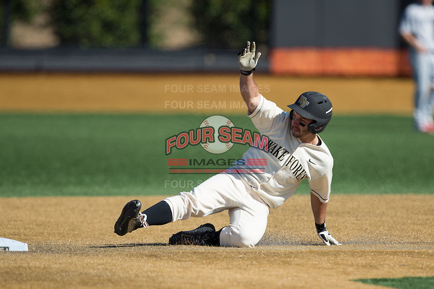 Joey Rodriguez (8) of the Wake Forest Demon Deacons slides into second base with a double against the Richmond Spiders at David F. Couch Ballpark on March 6, 2016 in Winston-Salem, North Carolina.  The Demon Deacons defeated the Spiders 17-4.  (Brian Westerholt/Four Seam Images)