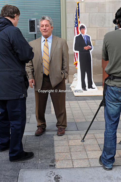 "Chicago Tribune columnist John Kass stands and smokes a cigarette near a cut-out of former Illinois Governor Rod Blagojevich after The Chicago Tribune held a contest to come up with the best name for Blagojevich's memoirs, at the announcement of the contest's winner, Kevin Floyd, 30, outside the Tribune Tower in Chicago, Illinois on March 6, 2009. Kevin Floyd, 30, is to be awarded a beef tongue for his winning entry, Rod and the Giant Impeach, after his entry surged ahead in the final minutes the online contest was open, leading Kass to speculate on Chicago-style election tactics in his column; the beef tongue was awarded ""in symbolic anticipation"" that the former governor will ""sing to the feds."""