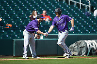 Jared Mihalik (33) of the Furman Paladins shakes hands with third base coach Taylor Harbin as he rounds the bases after hitting a solo home run against the Wake Forest Demon Deacons at BB&T BallPark on March 2, 2019 in Charlotte, North Carolina. The Demon Deacons defeated the Paladins 13-7. (Brian Westerholt/Four Seam Images)