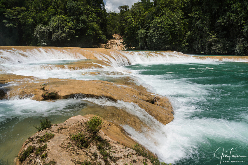 The Agua Azul Waterfalls are a series of cascades on the Xanil River in Chiapas, Mexico.  The river is a turquoise color because of the high mineral content in the water.  A faster camera shutter speed freezes the motion of the water.