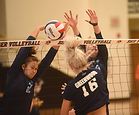 NWA Democrat-Gazette/FLIP PUTTHOFF <br /> Natalie Williams (2) makes a play for Har-Ber while Camryn Presley (16) defends for Greenwood on Saturday Sept. 7 2019 at the Bentonville Early Bird volleyball tournament.