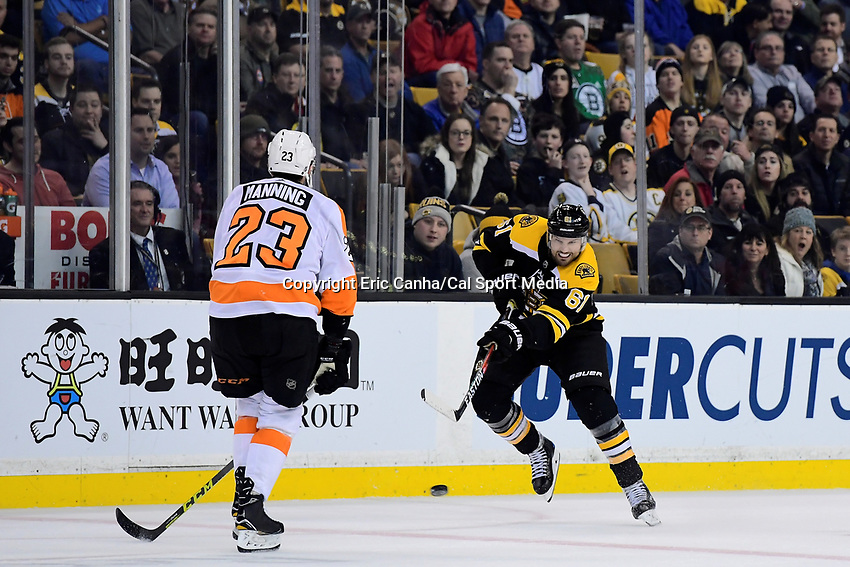 March 8, 2018: Boston Bruins left wing Rick Nash (61) passes the puck through the neutral zone during the NHL game between the Philadelphia Flyers and the Boston Bruins held at TD Garden, in Boston, Mass. Boston defeats Philadelphia 3-2 in regulation time. Eric Canha/CSM