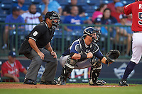 Umpire Jose Esteras and Pensacola Blue Wahoos catcher Cam Maron (9) during a game against the Mississippi Braves on May 28, 2015 at Trustmark Park in Pearl, Mississippi.  Mississippi  defeated Pensacola 4-2.  (Mike Janes/Four Seam Images)