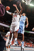 Virginia forward Akil Mitchell (25) grabs a rebound next to North Carolina forward Brice Johnson (11) during an NCAA basketball game against Virginia Monday Jan. 20, 2014 in Charlottesville, VA. Virginia defeated North Carolina 76-61.