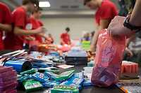 NWA Democrat-Gazette/CHARLIE KAIJO A group of boys make gift bags on Sunday, November 12, 2017 at the Circle of Life Hospice meeting room in Bentonville. Ninth and tenth grade boys from the Ozark Chapter of Young Men's Service League created care packages to send to a troop of 50 soldiers stationed in Kandahar, Afghanistan. Immediately prior to the service project, they heard firsthand experiences from a military veteran who was stationed in Kandahar.