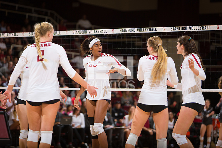 STANFORD, CA - October 12, 2018: Kathryn Plummer, Courtney Bowen, Jenna Gray, Audriana Fitzmorris at Maples Pavilion. No. 2 Stanford Cardinal swept No. 21 Washington State Cougars, 25-15, 30-28, 25-12.