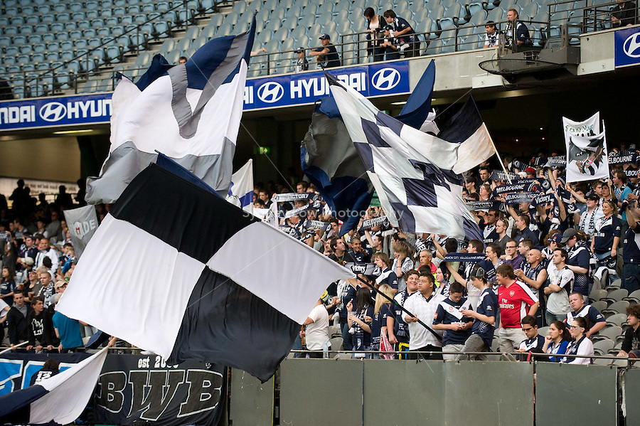 MELBOURNE, AUSTRALIA - NOVEMBER 06: Melbourne Victory fans cheer their team at the round 13 A-League match between the Melbourne Victory and Gold Coast United at Etihad Stadium on November 6, 2010 in Melbourne, Australia (Photo by Sydney Low / Asterisk Images)