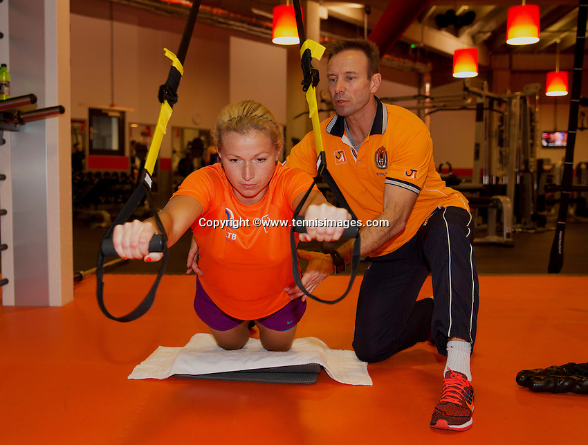 Februari 04, 2015, Apeldoorn, Omnisport, Fed Cup,  Netherlands-Slovakia, Fitness trainer  Miguel Janssen with  Michaella Krajicek <br /> Photo: Tennisimages/Henk Koster