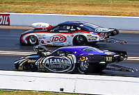 Sept. 2, 2013; Clermont, IN, USA: NHRA pro mod driver Rickie Smith (far lane) races alongside Von Smith during the US Nationals at Lucas Oil Raceway. Mandatory Credit: Mark J. Rebilas-
