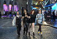 Pictured: People walk down Wind Street in the early hours of New Year's Day. Sunday 01 January 2017<br />