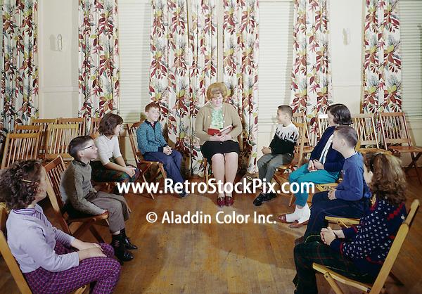 Metropolitan Motel, NJ. Woman reading a book to young children.