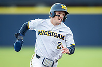 Michigan Wolverines shortstop Jack Blomgren (2) sprints around third base against the Western Michigan Broncos on March 18, 2019 in the NCAA baseball game at Ray Fisher Stadium in Ann Arbor, Michigan. Michigan defeated Western Michigan 12-5. (Andrew Woolley/Four Seam Images)