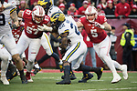 Wisconsin Badgers defensive lineman Alec James (57) and linebacker Garret Dooley (5) tackle Michigan Wolverines running back Karan Higdon (22) during an NCAA College Big Ten Conference football game Saturday, November 18, 2017, in Madison, Wis. The Badgers won 24-10. (Photo by David Stluka)