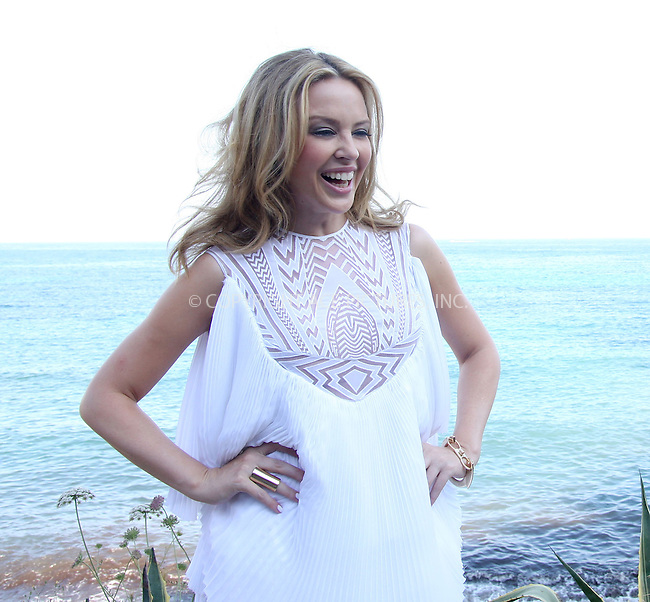 WWW.ACEPIXS.COM . . . . .  ..... . . . . US SALES ONLY . . . . .....Singer Kylie Minogue at a photocall Amante Beach Club on July 5 2010 in Ibiza....Please byline: FAMOUS-ACE PICTURES... . . . .  ....Ace Pictures, Inc:  ..tel: (212) 243 8787 or (646) 769 0430..e-mail: info@acepixs.com..web: http://www.acepixs.com