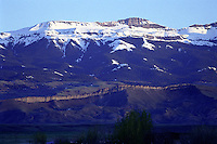 "Carter Mountain divides the South Fork of the Shoshone River on its northern slopes and the Greybull River on its southern slopes. The thin rim of ""wall"" which graces it's western slopes at the eastern end of the mountain will light up dramatically as the sun sets in the west, particularly in the summers months."