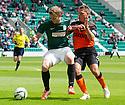 Hibs' Scott Robertson and Dundee Utd's John Rankin challenge for the ball.
