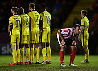 Lincoln City's Matt Rhead does his best to distract Cheltenham Town's Scott Flinders (out of picture) ahead of a free kick<br /> <br /> Photographer Chris Vaughan/CameraSport<br /> <br /> The EFL Sky Bet League Two - Lincoln City v Cheltenham Town - Tuesday 13th February 2018 - Sincil Bank - Lincoln<br /> <br /> World Copyright &copy; 2018 CameraSport. All rights reserved. 43 Linden Ave. Countesthorpe. Leicester. England. LE8 5PG - Tel: +44 (0) 116 277 4147 - admin@camerasport.com - www.camerasport.com