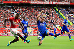 Luis Antonio Valencia of Manchester United crosses under pressure from Christian Fuchs of Leicester City during the Premier League match at Old Trafford Stadium, Manchester. Picture date: September 24th, 2016. Pic Sportimage
