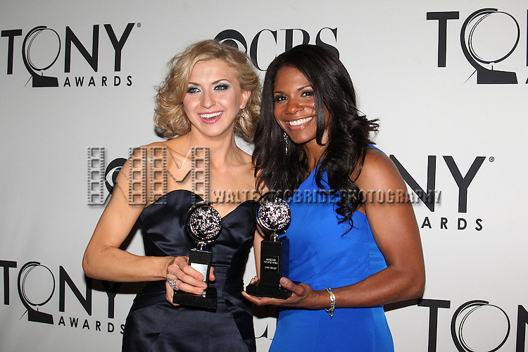 Audra McDonald; Nina Arianda  pictured at the 66th Annual Tony Awards held at The Beacon Theatre in New York City , New York on June 10, 2012. © Walter McBride / WM Photography