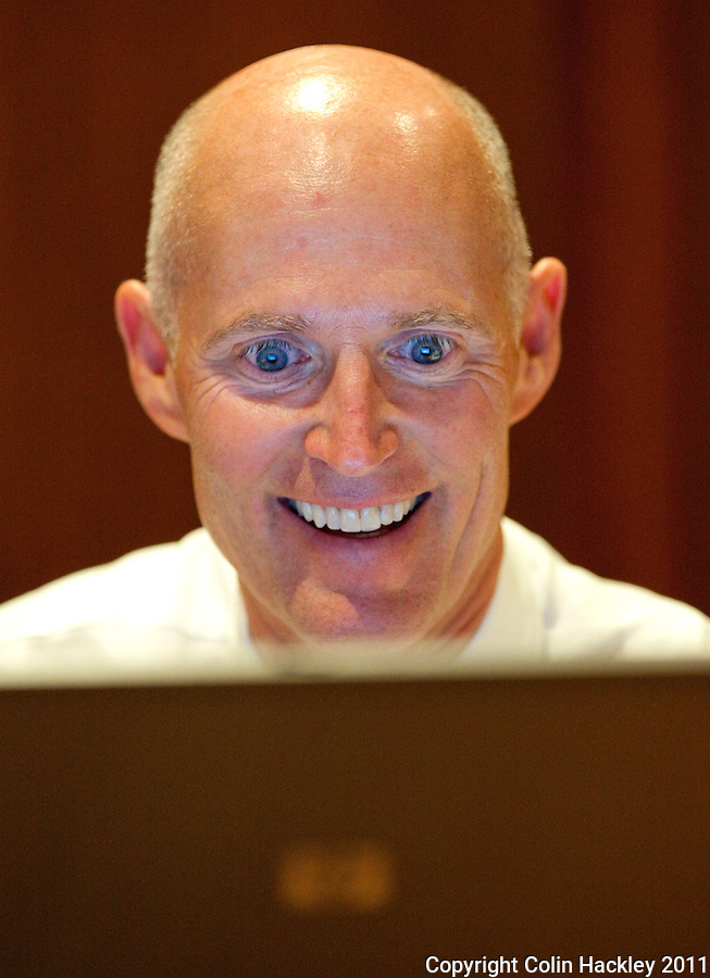 TALLAHASSEE, FLA. 1/20/11-SCOTT12011HACKLEY06-Gov. Rick Scott  reacts to a tweet during a Twitter town hall meeting Thursday at the Governor's Mansion in Tallahassee..COLIN HACKLEY PHOTO