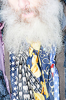 Media interview satirical presidential candidate Vermin Supreme as he protests his exclusion from the Lesser-Known Candidates Debate outside Saint Anselm College's New Hampshire Institute of Politics in Goffstown, New Hampshire. Supreme participated in previous debates, but was told he would be not allowed back this year because of an incident during the 2011 debate in which Supreme threw glitter on candidate Randall Terry. The college put up police tape behind which the candidate was told to stand without risking arrest. Supreme's platform advocates a pony-based economy, using zombies to solve the energy crisis, and other outlandish ideas. Supreme has been on the New Hampshire primary ballot in 2008 and 2012, though he has began running for president in 1992.
