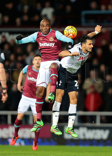 02.03.2016. Boleyn Ground, London, England. Barclays Premier League. West Ham versus Tottenham Hotspur. West Ham United Defender Angelo Ogbonna wins a climbing header against Tottenham Hotspur Midfielder Nacer Chadli