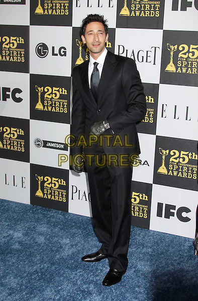 ADRIEN BRODY.25th Annual Film Independent Spirit Awards - Arrivals held at the Nokia Event Deck at L.A. Live, Los Angeles, California, USA, 5th March 2010..indie full length black suit tie gloves leather.CAP/ADM/MJ.©Michael Jade/AdMedia/Capital Pictures.