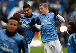 Real Madrid CF's Toni Kroos and Real Madrid CF's Carlos H. Casemiro  warms up before the Spanish La Liga match round 20 between Real Madrid and Granada CF at Santiago Bernabeu Stadium in Madrid, Spain
