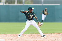 Oakland Athletics second baseman Marcos Brito (5) throws to first base during an exhibition game against Team Italy at Lew Wolff Training Complex on October 3, 2018 in Mesa, Arizona. (Zachary Lucy/Four Seam Images)