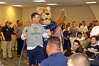 12 August 2011:  FIU Football Head Coach Mario Cristobal, joined by mascot Roary, addresses fans during the FIU 2011 Panther Preview at University Park Stadium in Miami, Florida.