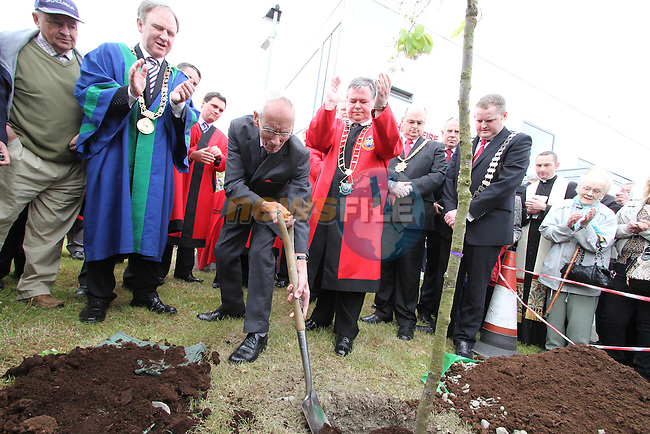 John Gray who was one of the firefighters who went to Belfast to aid his colleagues.  Here he plants a tree with Mayor of Drogheda, Paul Bell, Mayor of Dublin, Gerry Breen and Mayor of Belfast, Pat Convery at A special commemoration in Drogheda marking the involvement of fire-fighters from Drogheda and Dundalk in the aftermath of the Belfast Blitz...(Photo credit should read Jenny Matthews www.newsfile.ie)....This Picture has been sent you under the conditions enclosed by:.Newsfile Ltd..The Studio,.Millmount Abbey,.Drogheda,.Co Meath..Ireland..Tel: +353(0)41-9871240.Fax: +353(0)41-9871260.GSM: +353(0)86-2500958.email: pictures@newsfile.ie.www.newsfile.ie.