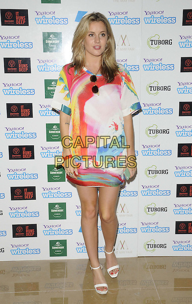 Caggie Dunlop<br /> attended the Yahoo! Wireless Festival pre-party, The May Fair Hotel, Stratton Street, Mayfair, London, England, UK,19th June 2013.<br /> full length red white blue multi-coloured print dress ankle strap open toe sandals <br /> CAP/CAN<br /> &copy;Can Nguyen/Capital Pictures