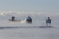 The Philip R. Clarke emerges from Lake Superior's sea smoke as it nears Two Harbors, Minnesota.