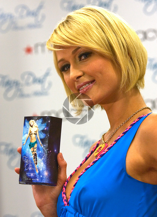 031409tvhiltonfairy.Paris Hilton holds a box of her Fairy Dust fragrance during her visit to Macy's at St. Clair Square..BND/TIM VIZER   with story