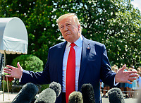United States President Donald J. Trump makes remarks and answers reporter's questions as he prepares to depart the South Lawn of the White House in Washington, DC on Friday, July 5, 2019.  The President will travel to Westminster, New Jersey for the weekend. Photo Credit: Ron Sachs/CNP/AdMedia