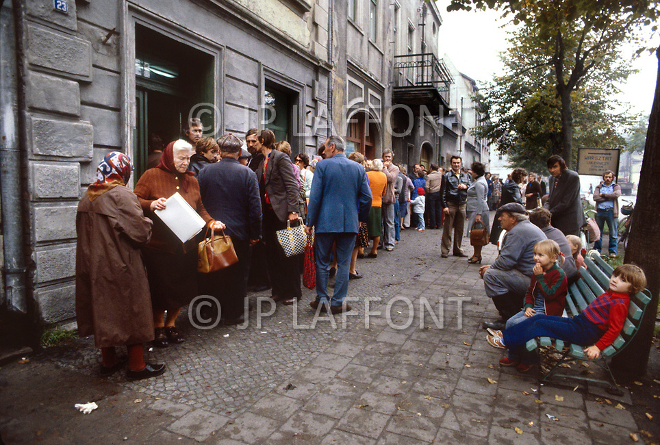 Poland, September, 1981 - People line up for a bakery in the Torun region. Because most of what is grown in Poland is distributed elsewhere in the USSR, shoppers endure long lines and shortages of nearly everything.
