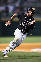 Micah Johnson (3) of the Charlotte Knights rounds third base during the game against the Columbus Clippers at BB&T BallPark on May 27, 2015 in Charlotte, North Carolina.  The Clippers defeated the Knights 9-3.  (Brian Westerholt/Four Seam Images)