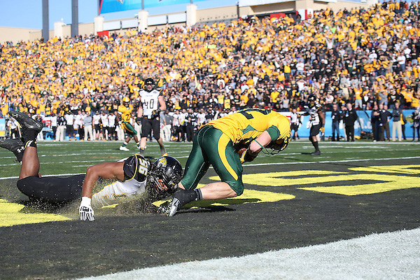 FRISCO, TX  JANUARY 4:  Ryan Delaire #56 of the Towson Tigers has a tackle on Zach Vraa #82 of the North Dakota State Bison making a touchdown at  the Division 1 Football Championship at Toyota Stadium in Frisco on January 4, 2014 in Frisco, NDSU won 35-7. TX.  Photo by Rick Yeatts